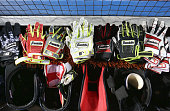 A set of Franklin batting gloves and helmets prepared on the top step of the Boston Red Sox dugout before the start of MLB game action against the...