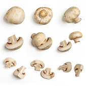Set of fresh whole and sliced champignon mushrooms isolated on white background. Top view.