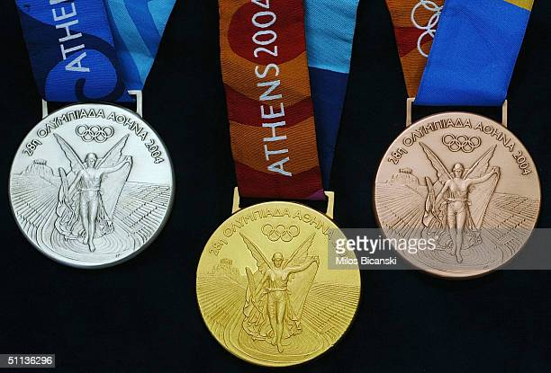 A set of Gold Silver and Bronze medals for the forthcoming Athens Olympics 2004 displayed August 2 2004 in Athens Greece Each medal weighs 150 grams...
