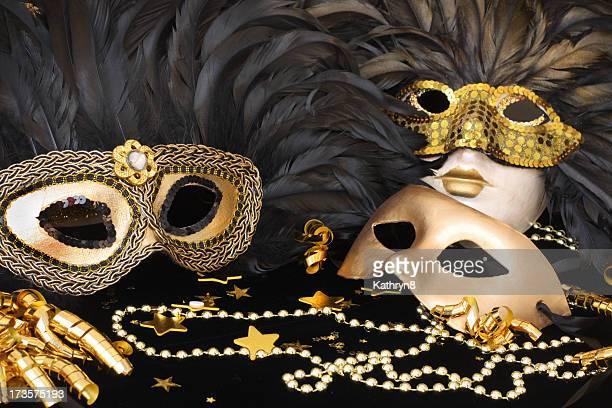Set of golden mardi grass masks with feathers