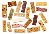Top view of various healthy granola bars (muesli or cereal bar). Set of protein bar isolated on white background