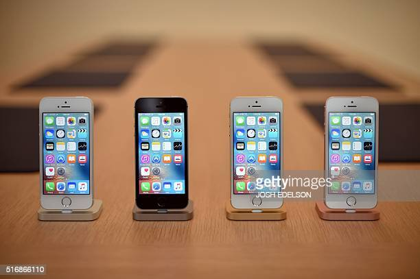 A set of iPhone SE handsets are seen on display during a media event at Apple headquarters in Cupertino California on March 21 2016 The new iPhone SE...