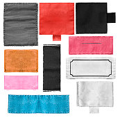 Set of blank textile colorful clothes labels isolated over white