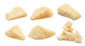 Set of Parmesan cheese pieces on white background