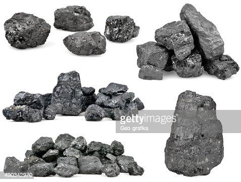 Set of piles of coal isolated on white : Stock Photo