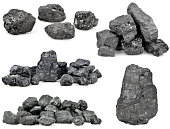 Set of piles of coal isolated on white background.
