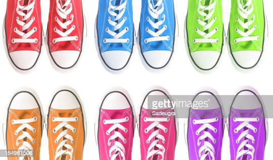 Set of six colorful sneakers over a white background