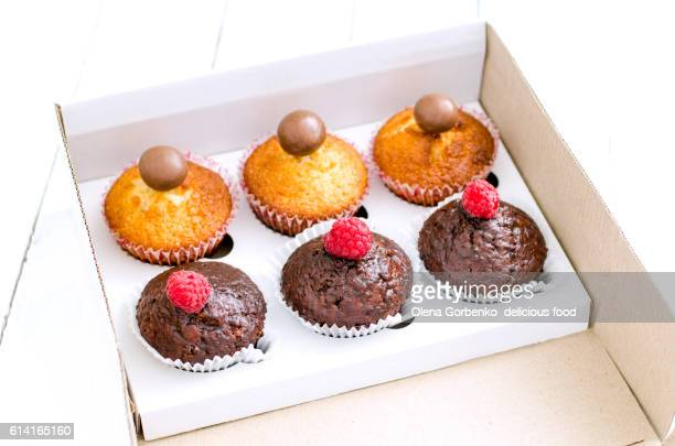 Set of six delicious cupcakes in a paper box