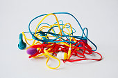 Set of tangled red, yellow and aquamarine head-phones