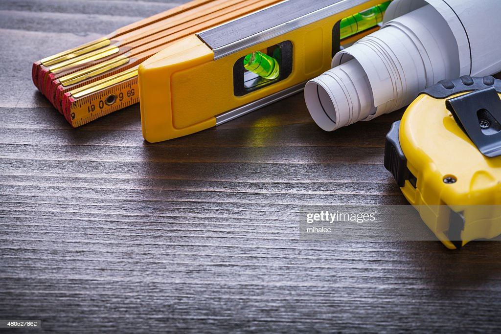 Set of tape-measure blueprints construction level and wooden met : Stock Photo