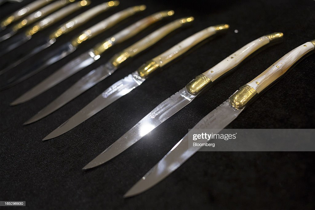 A set of ten Laguiole table knives from the former El Bulli restaurant, to be auctioned at Sotheby's, are arranged for a photograph in Hong Kong, China, on Monday, April 1, 2013. Fans who mourned the closing of El Bulli in 2011 will get a chance to buy a piece of its history at a Sotheby's auction in Hong Kong today. Photographer: Jerome Favre/Bloomberg via Getty Images