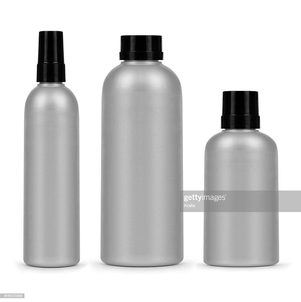 set of three cosmetic bottles isolated on a white background : Foto stock