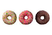 Set of three different colorful donuts isolated on white background.