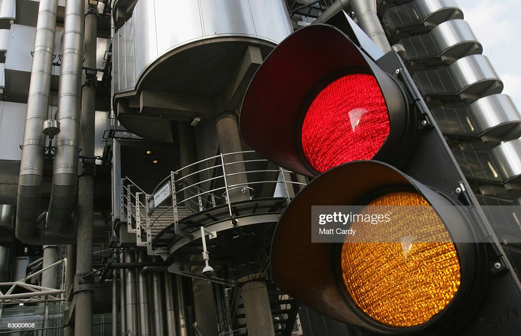 A set of traffic lights slows traffic opposite the Lloyd's Building, the home of the insurance institution Lloyd's of London on September 25 2008 in London, England. Lloyds of London are due to announce their interim results today as US President George Bush calls for the Ameriacn people to support his multi billion dollar rescue plan for the US economy.
