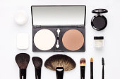 Set of various makeup brushes with eyeshadows, cream  and blusher kit. Cosmetics top view image