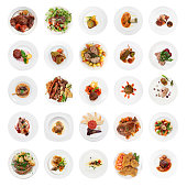 Set of various meat dishes shot from above, isolated on white background
