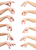 Taking, measuring. Set of caucasian male and female hands grab some items. Isolated at white background