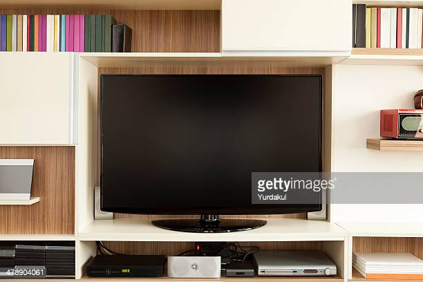 TV set on wall unit