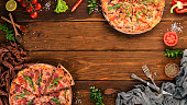 Set pizza. Italian cuisine. Top view. On a wooden background. Copy space.
