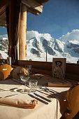 Set table at ski lodge restaurant