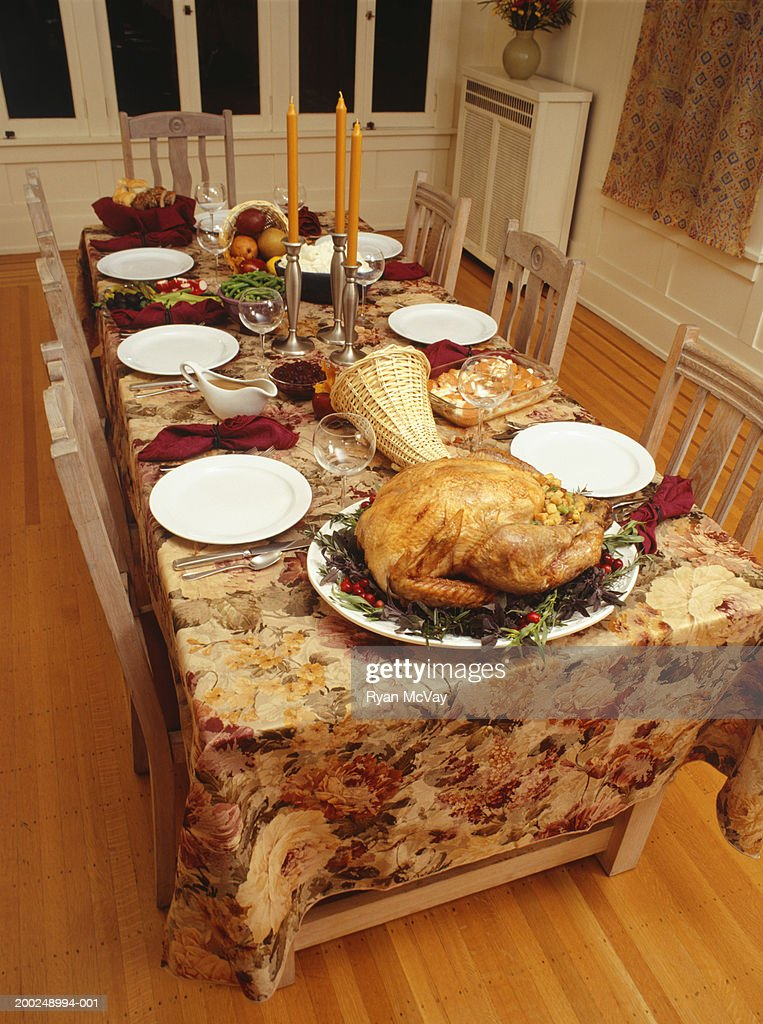 Set table for thanksgiving dinner stock photo getty images How to set a thanksgiving dinner table