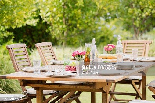 Set table in backyard