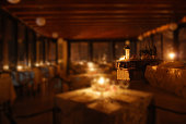 set tables of an elegant restaurant by candlelight