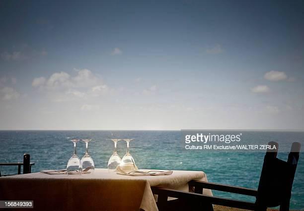Set table overlooking ocean