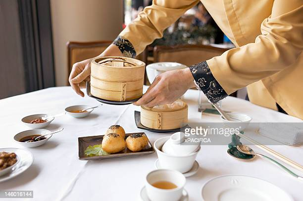 A set table with tea and dim sum