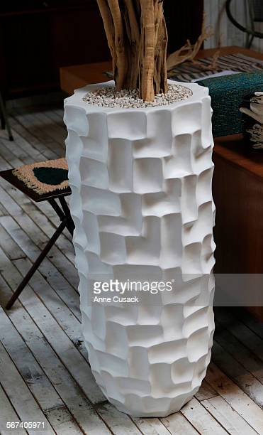 Set this strongly textural cylinder against a larger cleanlined box or ball planter for best effect Cell Pot polyresin in matte white 14 by 35 inches...