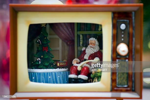 A TV set with a Santa Claus is displayed for sale in a department store in Paris on December 16 one week ahead of Christmas feast AFP PHOTO JOEL SAGET
