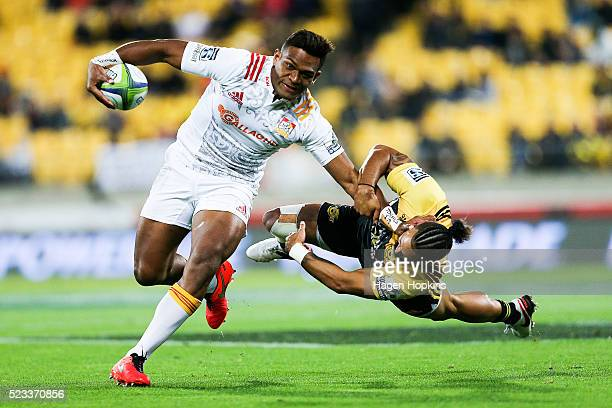 Seta Tamanivalu of the Chiefs fends Matt Proctor of the Hurricanes during the round nine Super Rugby match between the Hurricanes and the Chiefs at...
