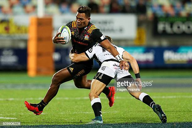 Seta Tamanivalu of the Chiefs is tackled by Paul Jordaan of the Sharks during the round 10 Super Rugby match between the Chiefs and the Sharks at...