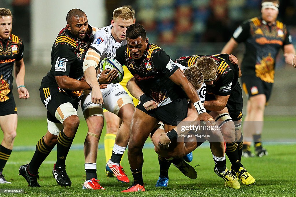 Seta Tamanivalu of the Chiefs is tackled during the round 10 Super Rugby match between the Chiefs and the Sharks at Yarrow Stadium on April 29, 2016 in New Plymouth, New Zealand.