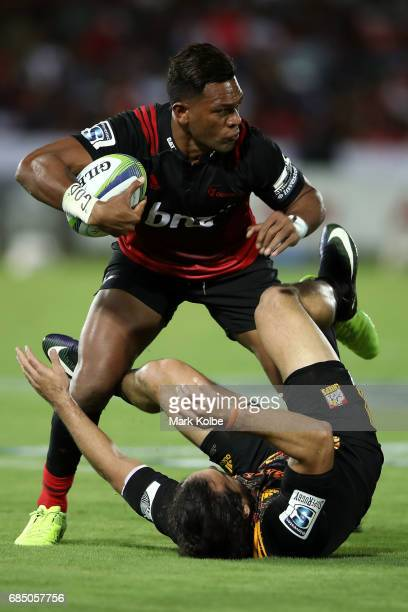 Seta Tamanivalu of the Crusaders is tackled by James Lowe of the Chiefs during the round 13 Super Rugby match between the Chiefs and the Crusaders at...
