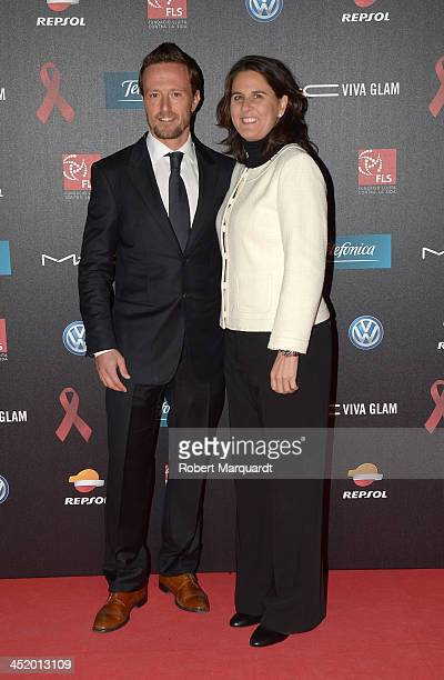 Sete Gibernau and Conchita Martinez pose during a photocall for the '4th Annual Gala Sida Barcelona 2013' held at the El Museo Nacional de Arte de...