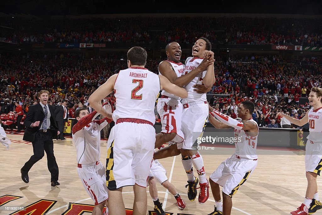 Seth Allen #4 and Dez Wells #32 of the Maryland Terrapins celebrate with teammates after a 83-81 victory over the Duke Blue Devils at the Comcast Center on February 16, 2013 in College Park, Maryland.