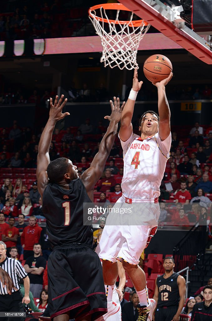 Seth Allen #4 of the Maryland Terrapins drives to the hoop against the IUPUI Jaguars at the Comcast Center on January 1, 2013 in College Park, Maryland.