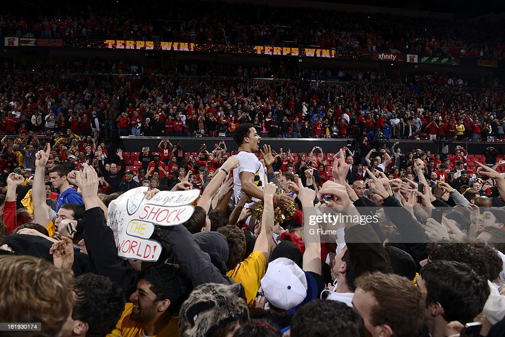 Seth Allen #4 of the Maryland Terrapins is lifted up by fans after a 83-81 victory over the Duke Blue Devils at the Comcast Center on February 16, 2013 in College Park, Maryland.