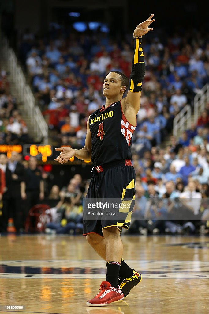 Seth Allen #4 of the Maryland Terrapins reacts after shooting a three-pointer in the first half against the North Carolina Tar Heels during the men's ACC Tournament semifinals at Greensboro Coliseum on March 16, 2013 in Greensboro, North Carolina.