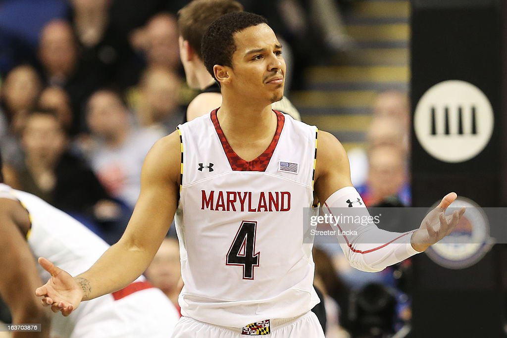 Seth Allen #4 of the Maryland Terrapins reacts in the second half against the Wake Forest Demon Deacons during the first round of the Men's ACC Basketball Tournament at Greensboro Coliseum on March 14, 2013 in Greensboro, North Carolina.