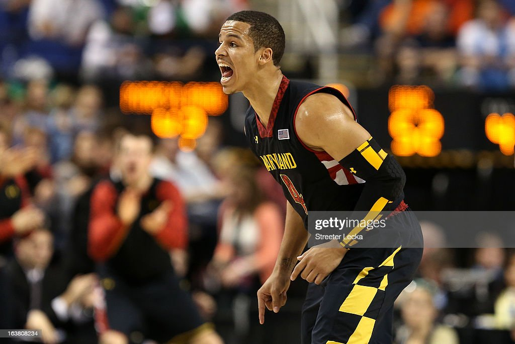 Seth Allen #4 of the Maryland Terrapins reacts in the second half while taking on the North Carolina Tar Heels during the men's ACC Tournament semifinals at Greensboro Coliseum on March 16, 2013 in Greensboro, North Carolina.