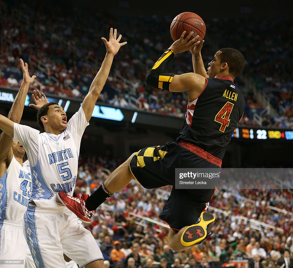 Seth Allen #4 of the Maryland Terrapins shoots over Marcus Paige #5 of the North Carolina Tar Heels in the first half during the men's ACC Tournament semifinals at Greensboro Coliseum on March 16, 2013 in Greensboro, North Carolina.