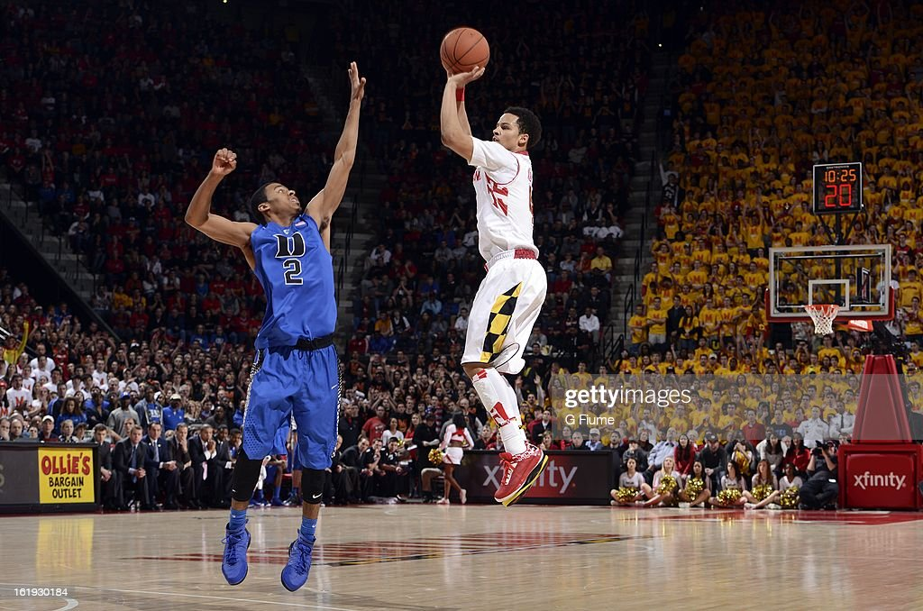 Seth Allen #4 of the Maryland Terrapins shoots the ball over Quinn Cook #2 of the Duke Blue Devils at the Comcast Center on February 16, 2013 in College Park, Maryland.