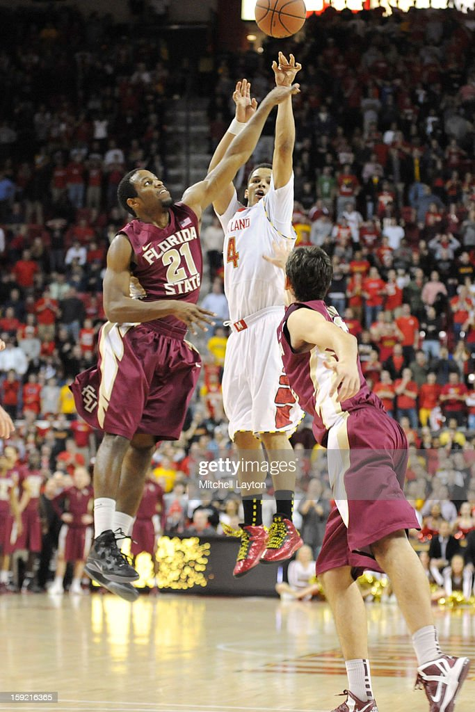 Seth Allen #4 of the Maryland Terrapins takes a shot over Michael Snaer #21 of the Florida Semiinoles during a college basketball game on January 9, 2013 at the Comcast Center in College Park, Maryland.