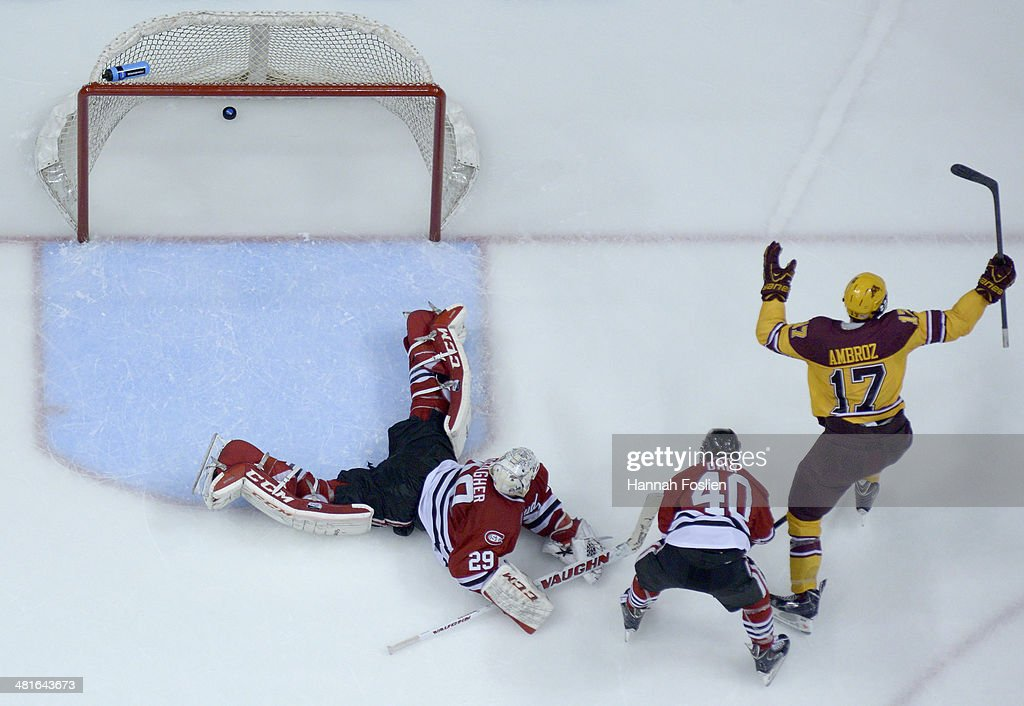 Seth Ambroz #17 of the Minnesota Golden Gophers celebrates scoring a goal against Ryan Faragher #29 of the St. Cloud State Huskies as <a gi-track='captionPersonalityLinkClicked' href=/galleries/search?phrase=Tim+Daly&family=editorial&specificpeople=206405 ng-click='$event.stopPropagation()'>Tim Daly</a> #4o of <a gi-track='captionPersonalityLinkClicked' href=/galleries/search?phrase=Tim+Daly&family=editorial&specificpeople=206405 ng-click='$event.stopPropagation()'>Tim Daly</a> #40 of the St. Cloud State Huskies looks on during the second period of the final game in the West Regional of the 2014 NCAA Division I Men's Ice Hockey Championship on March 30, 2014 at Xcel Energy Center in St Paul, Minnesota. The Minnesota Golden Gophers defeated the St. Cloud State Huskies 4-0.