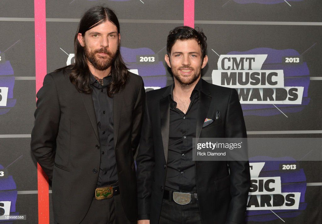 <a gi-track='captionPersonalityLinkClicked' href=/galleries/search?phrase=Seth+Avett&family=editorial&specificpeople=4271007 ng-click='$event.stopPropagation()'>Seth Avett</a> and <a gi-track='captionPersonalityLinkClicked' href=/galleries/search?phrase=Scott+Avett&family=editorial&specificpeople=4271008 ng-click='$event.stopPropagation()'>Scott Avett</a> of The Avett Brothers attend the 2013 CMT Music awards at the Bridgestone Arena on June 5, 2013 in Nashville, Tennessee.