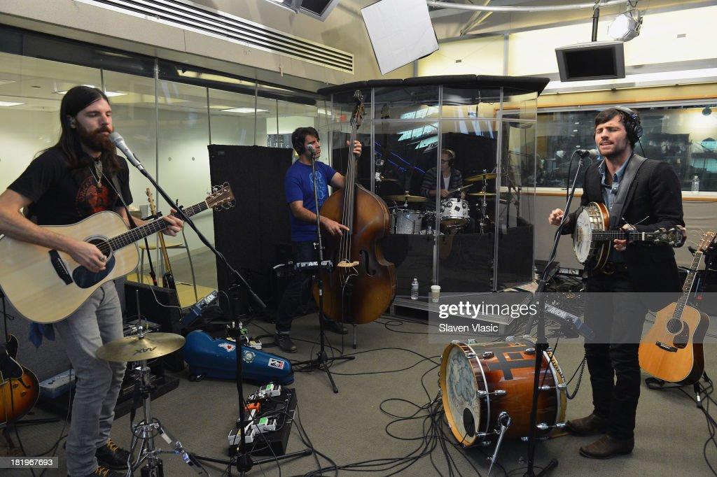 Seth Avett, Bob Crawford and Scott Avett of The Avett Brothers perform at SiriusXM Studios on September 26, 2013 in New York City.