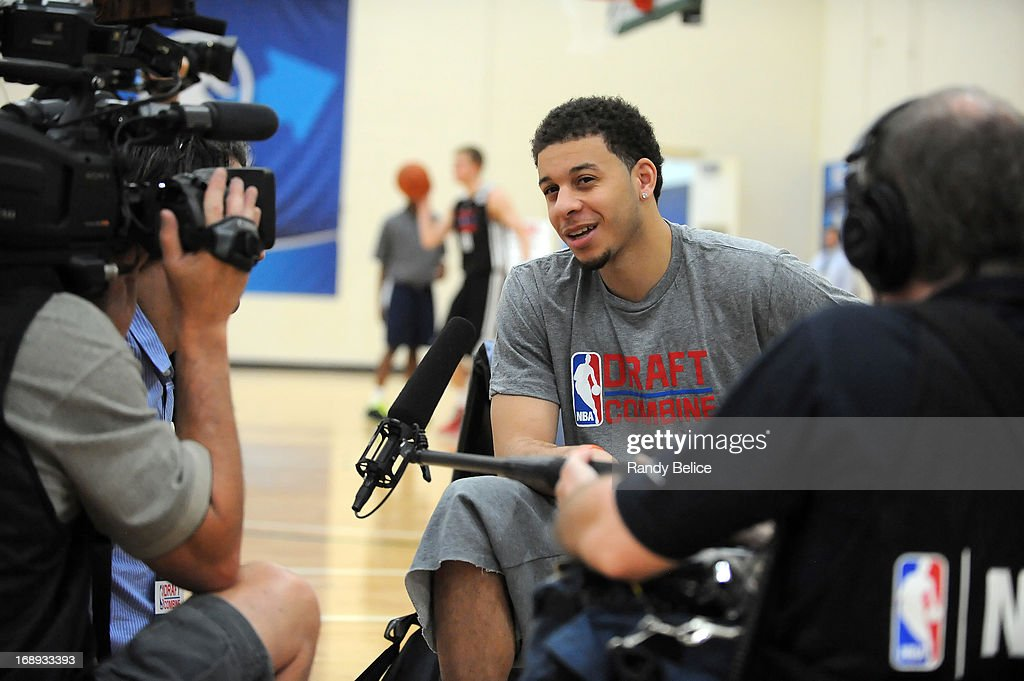 Seth Curry conducts an interview during Day 1 of the 2013 NBA Draft Combine on May 16, 2013 at Quest Multiplex in Chicago, Illinois. Curry was not able to participate in the drills and testing as he is recovering from surgery to his right shin performed in mid-April.