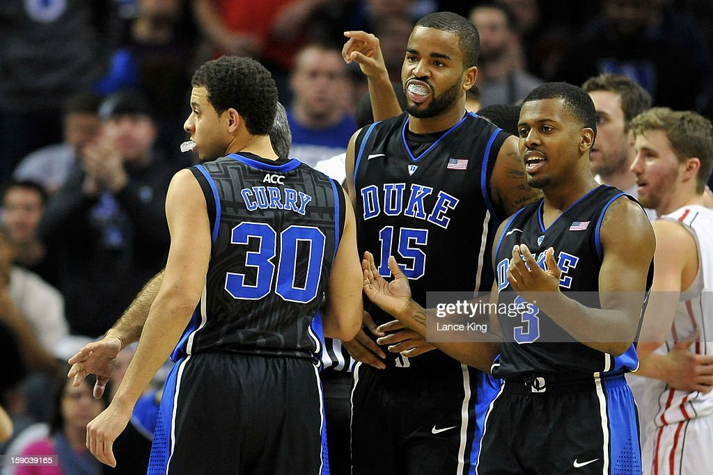 Seth Curry #30, Josh Hairston #15 and Tyler Thornton #3 of the Duke Blue Devils look toward their bench during a game against the Davidson Wildcats at Time Warner Cable Arena on January 2, 2013 in Charlotte, North Carolina. Duke defeated Davidson 67-50.